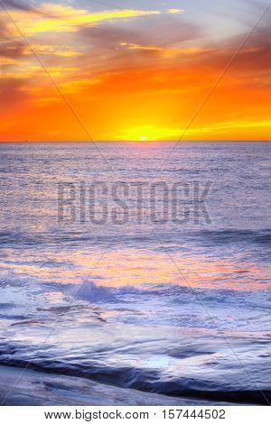 Pacific ocean sunset in California in Windansea beach in La Jolla, San Diego with orange sun reflection