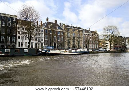 AMSTERDAM HOLLAND, MARCH 28 2015: landscape of the houses in front of canals Amsterdam Holland. Editorial use.