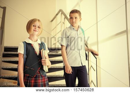 Cute schoolkids on staircases