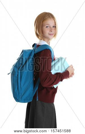 Girl with schoolbag and books isolated on white
