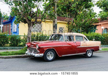 CIENFUEGOS, CUBA - MARCH 22, 2016: Oldschool vintage automobile parked in Cienfuegos Cuba