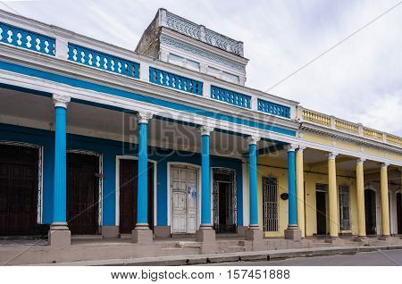 CIENFUEGOS, CUBA - MARCH 22, 2016: Colonial building with columns in Cienfuegos Cuba
