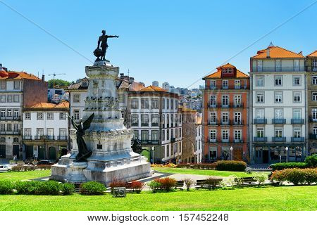 Monument to Prince Henry The Navigator Infante Dom Henrique and colorful facades of old houses in the historic centre of Porto Portugal. Porto is one of the most popular tourist destinations in Europe. poster