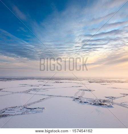 Aerial view of the frozen lake on which are made petroleum production. Roads were run directly through the lake.