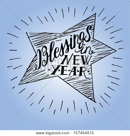 Hand lettering made in shape of a star with the inscription of Blessings in new year