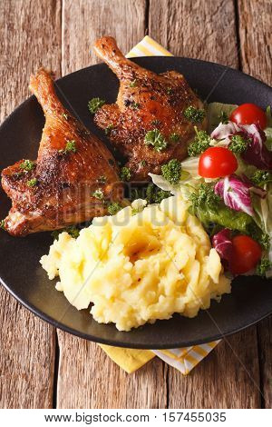 Roasted Duck Leg With Mashed Potatoes Garnish And Salad Mix Close-up. Vertical