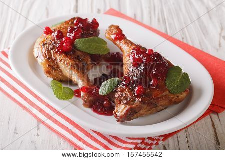 Delicious Baked Duck Leg With Cranberry Sauce And Mint Closeup. Horizontal