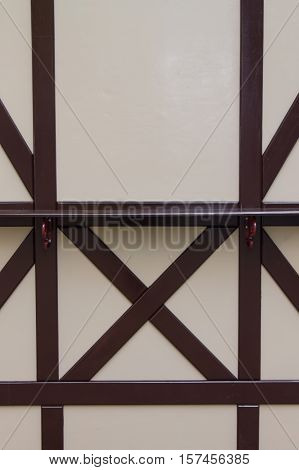 background of light colored wooden wall with brown wooden beams