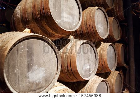 Port Wine From The Vineyards Douro Valley In Portugal Aging In Oak Barrels Stacked In The Old Cellar