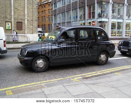 LONDON UK - CIRCA NOVEMBER 2009: Black taxi cab in a street of the city centre