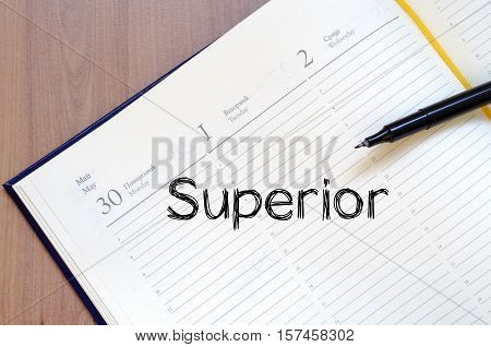 Superior text concept write on notebook .