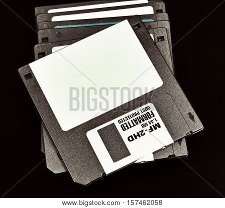 old floppy disk with a capacity of 1.4 megabytes on a black background.