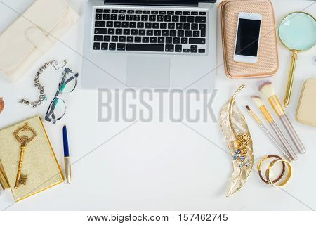 Laptop keyboard with golden woman accessories mock up flat lay scene, top view, copy space on white table background