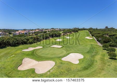 The well-kept golf course in the summer. For players.