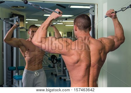 Strong with muscular body at the gym