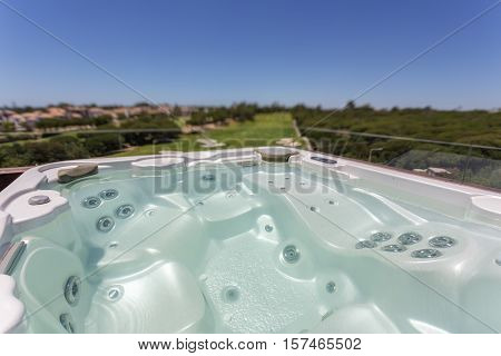 Relaxing round jacuzzi outdoor. With views of the golf course