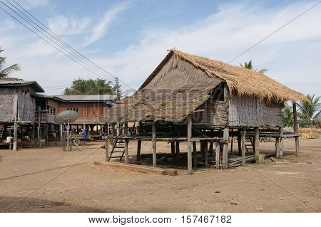 PAKXE, LAOS - FEBRUARY 25, 2016: Traditional village of minority group close to Pakxe on February 25, 2016 in Laos, Asia