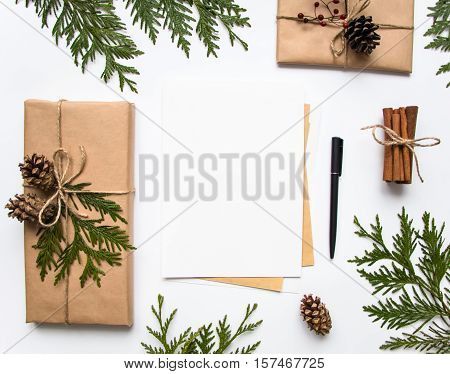 Gift Boxes In Craft Paper And A Letter On White Background. Christmas Or Other Holiday Concept, Top