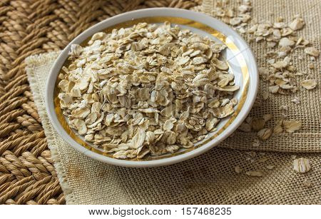 raw oatmeal in the saucer. raw oatmeal.