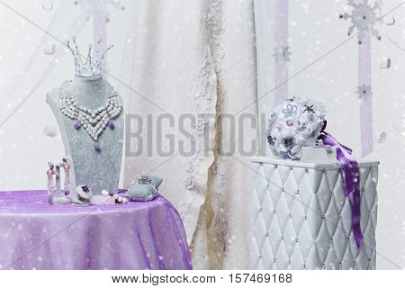 Beautiful set of natural stone bridal accessories including necklace, ring, earrings, bracelets, princess crown and wedding bouquet.