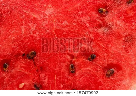 A slice of juicy ripe red watermelon closeup