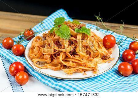 tasty pasta-Italian meat sauce Tagliatelle on the table
