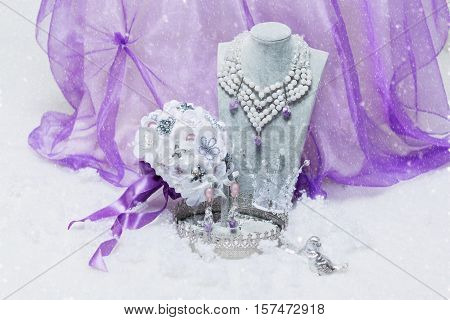 Beautiful set of natural stone bridal accessories including necklace, ring, earrings, bracelets and wedding bouquet. Copy space.