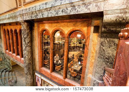 PRAGUE - MAY 16, 2014: People sit in cafe inside the historical Lucerna Palace on May 16, 2014 in Czech Republic. Lucerna Palace is Art Nouveau building built in 1921 by former President Vaclav Havel family