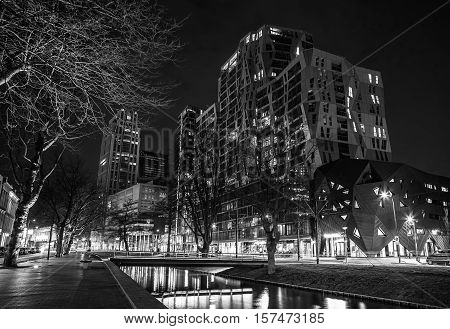 ROTTERDAM NETHERLANDS - DECEMBER 26 2015: Black-white photo of famous city sights at night time on December 26 2015 in Rotterdam - Netherlands.
