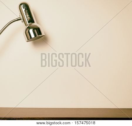 Metal silver light table lamp with background copy space for product