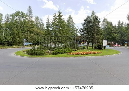 ZAKOPANE POLAND - SEPTEMBER 12 2016: Kuznickie Roundabout was built in 1938 during the preparations for the World Cup FIS. It is named after Pope John Paul II since 2006