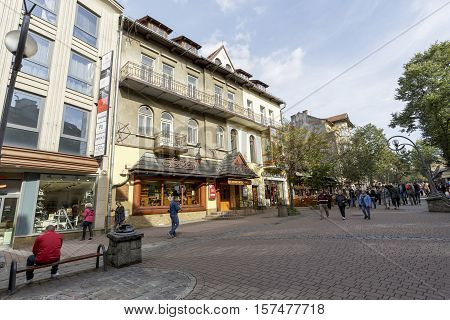 ZAKOPANE POLAND - SEPTEMBER 23 2016: Townhouse called Podhale at the Krupowki. On the ground floor the entrance to the grocery store decorated with shingled roof refers to tradition of the region