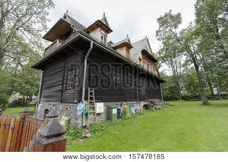 ZAKOPANE POLAND - SEPTEMBER 20 2016: Wooden villa named Ornak in Zakopane can be seen from backyard side. This villa was built in the early twentieth century and is a monument of wooden architecture