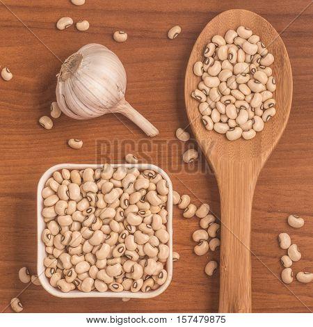 Fradinho Kidney Beans. White Beans over a wooden table