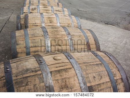 Bend in Row of Rolling Bourbon Barrels at distillery