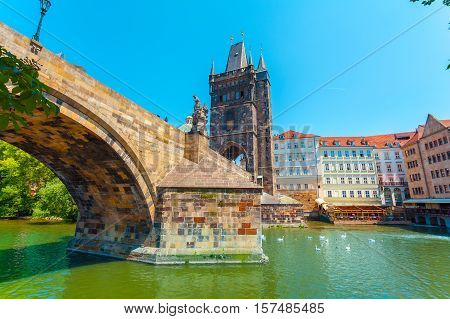 Colorful image of Old Town Bridge Tower in Prague and Charles Bridge, Czech Republic. View from the water