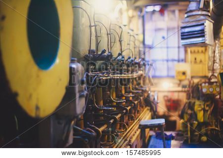 Engine Room on a cargo boat ship interior, ship's engine heavy Machinery Space - Pipes, Valves, Engines, oil rig platform interior