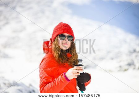 Hiker With A Thermos In His Hands.