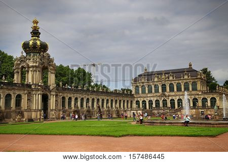 DRESDEN GERMANY - AUGUST 13 2016: Tourists walk and visit Dresdner Zwinger rebuilt after the second world war the palace is now the most visited monument in Dresden Germany on August 13 2016.