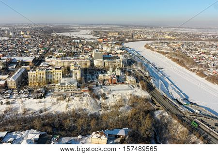 Tyumen, Russia - February 15, 2016: Aerial view onto Nikolsky Vzvoz, Krestovozdvizhensky temple, State architectural and construction university, Holy Trinity Monastery and Tura river quay poster
