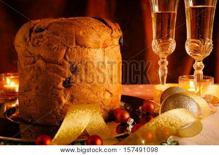 Closeup of Christmas cake and sparkling wine with Christmas decorations