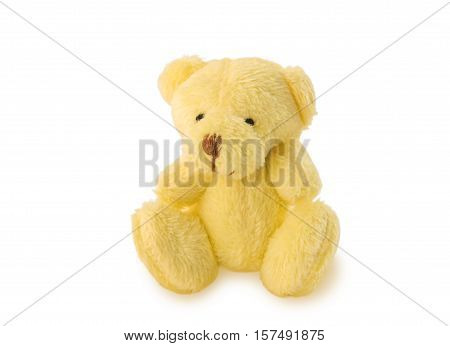 Sitting teddy bear soft toy isolated over white.