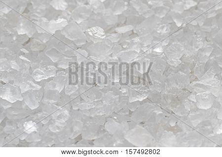 Sea salt crystals background . Marine coarse salt.
