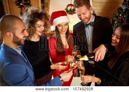 Friends toasting with Champaign at midnight for New Year