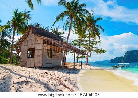 Scenic tropical landscape El Nido Palawan Philippines Southeast Asia. Beautiful tropical island with hut sandy beach palms. Sea bay scenery. Popular landmark tourist destination of Philippines