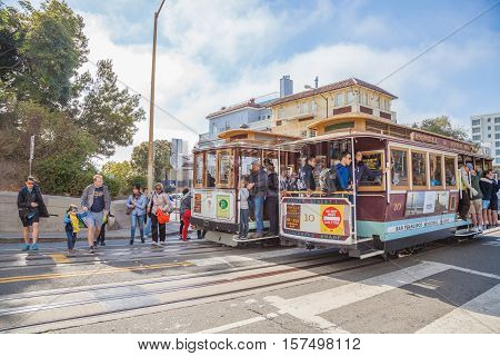 San Francisco, California, United States - August 16, 2016: Two Cable Car, Powell-Hyde lines stopped at intersection between Hyde and Lombard Street, popular touristic attraction.