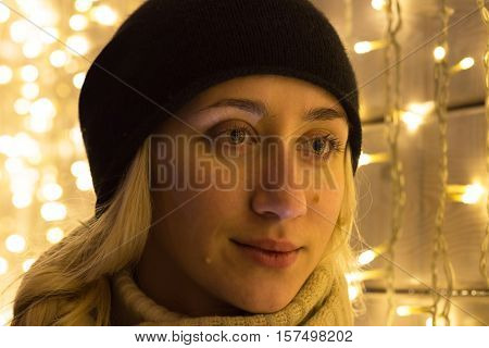 Art portrait of a beautiful girl. Gorgeous blonde girl portrait in night city lights. Vogue fashion style portrait of young pretty beautiful woman with long blonde curly hair.
