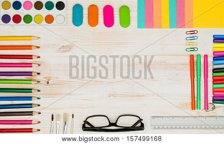 Office table or desk seen from above. Top view product photograph. Shool or university concept image. Back to school background.