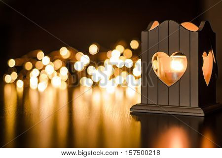 Heart shaped candlelight with unfocused lights in background