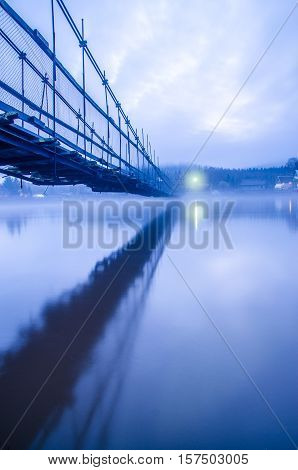 floating bridge in the fog. rustic bridge in fog. rural bridge in fog. Bridge in dense fog